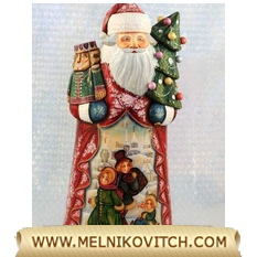 Santa Claus figurine with Christmas tree and wooden Nutcracker