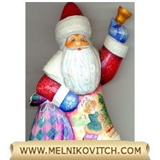 ​Christmas decoration: Santa Claus with bell and 2 girls