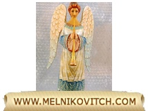 Angel with a trumpet (wooden figure) is announcing good news