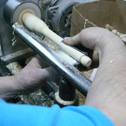 Then he makes blanks of bars and carves out of them details for future souvenirs and handmade toys.